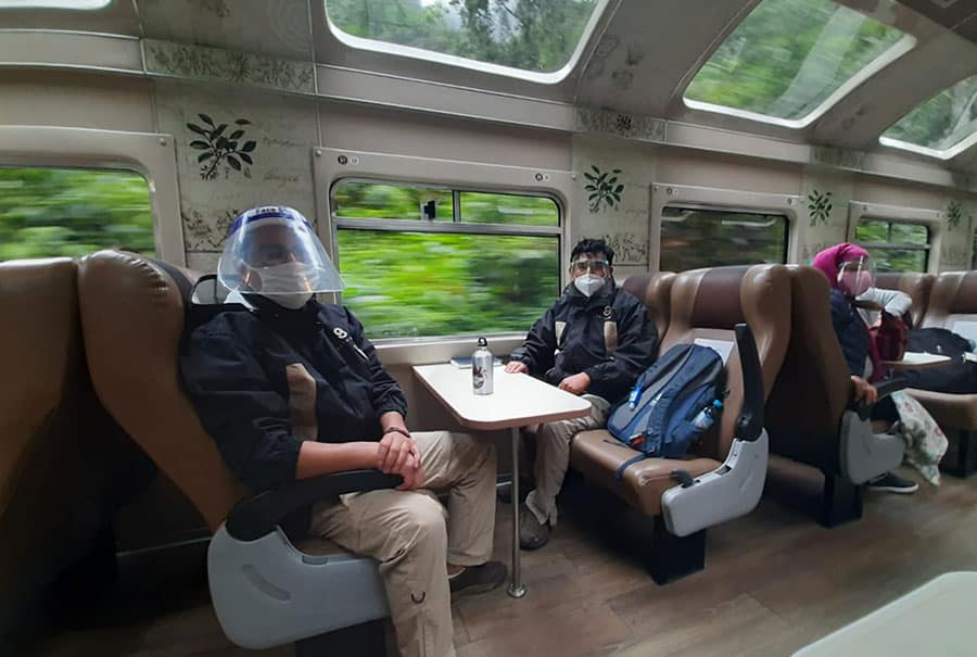 Passengers wearing face shields and masks traveling with PeruRail after Machu Picchu's re-opening