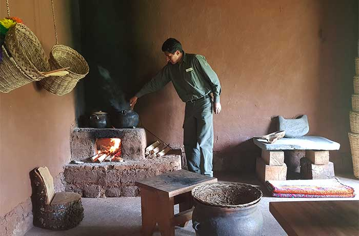 An Inkaterra guide cooking 'chicha' during a demo how to prepare maize beer in the Sacred Valley