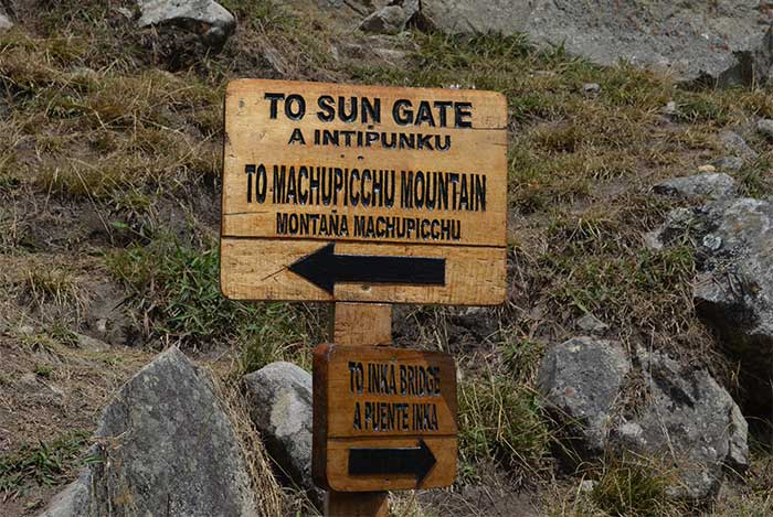 Sign in Machu Picchu showing the direction to get to Inti Punku Sun Gate