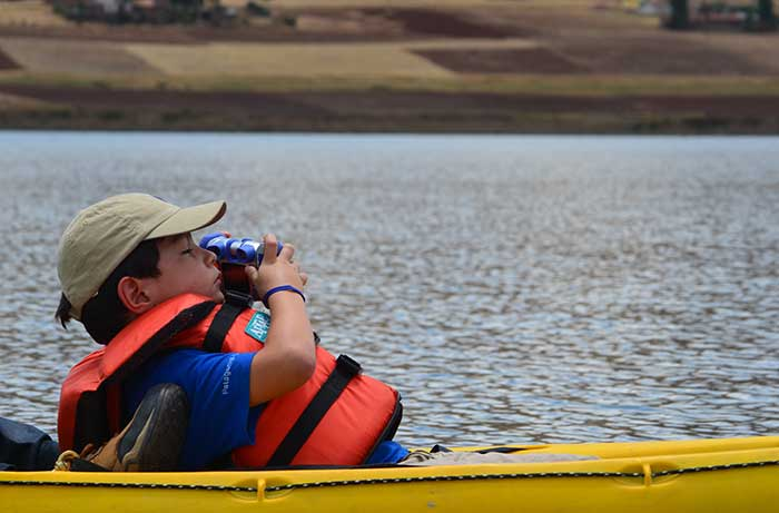 Kid doing kayaking at Huaypo Lake in the Sacred Valley of the Incas Cusco