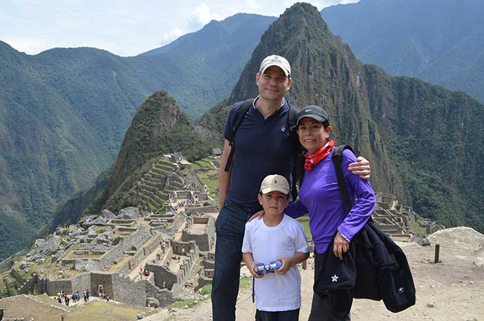 Machu Picchu with Kids, a family of three with Machu Picchu as backdrop