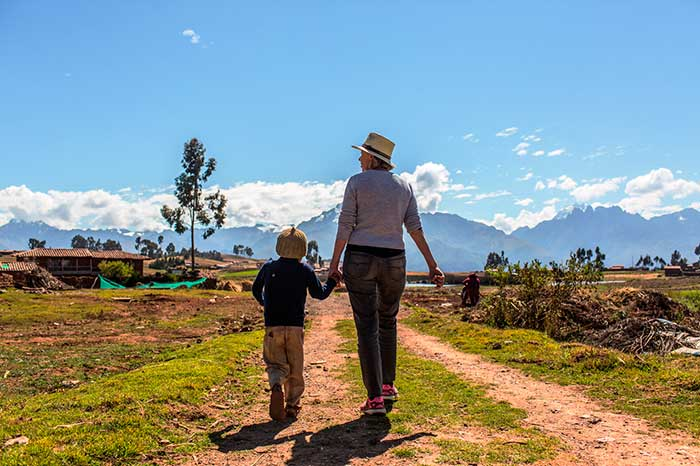 Petit founder of the Sol y Luna Hotel and the foundation of the same name walking with a kid of the Sacred Valley