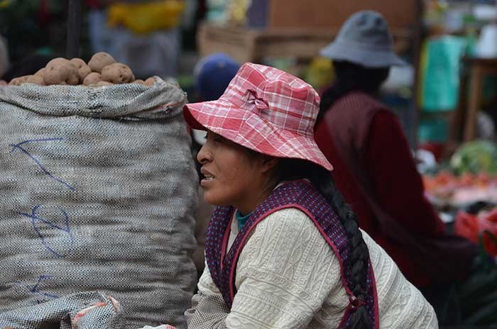 Local lady selling different sorts of potatoes at Pisaq Market in the Sacred Valley