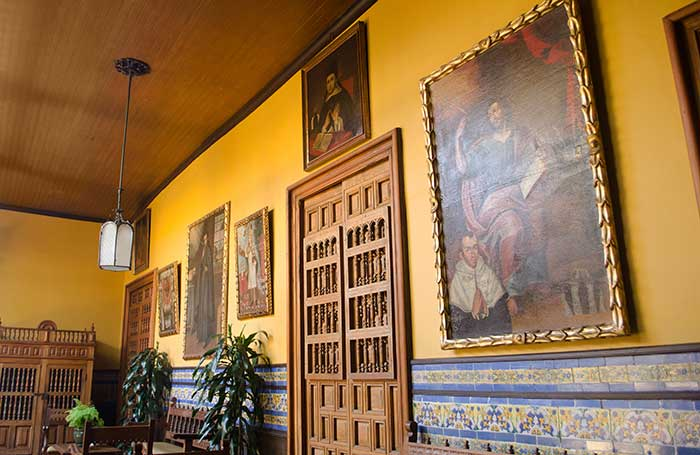Inner courtyard with colonial paintings at Casa Aliaga