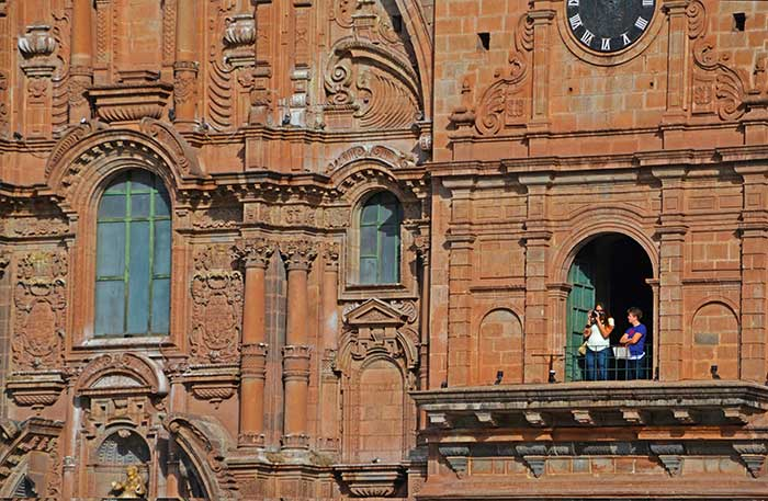 A traveler photographing from La Compania Church