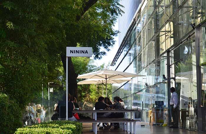 Cafe Malba's cafeteria ft. an outdoor terrace with trees