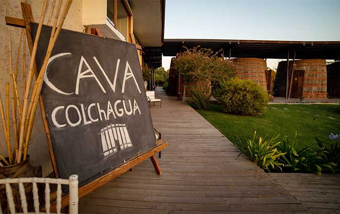 Santiago's Vineyards - Sign of Cava Colchagua with wine barrels in the background