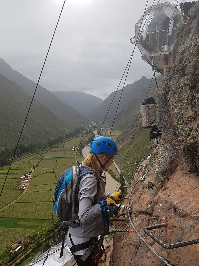 Maria climbing the via ferrata up to the Skylodge, almost there