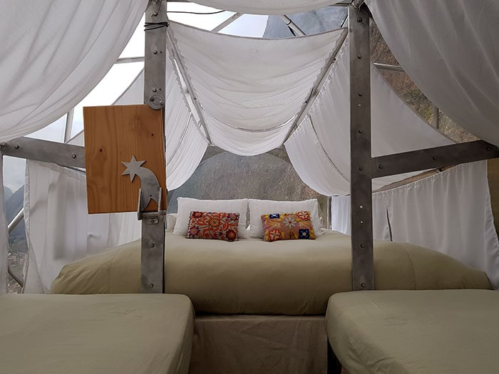 Three green beds at one of the pods of Skylodge overlooking the Sacred Valley of the Incas