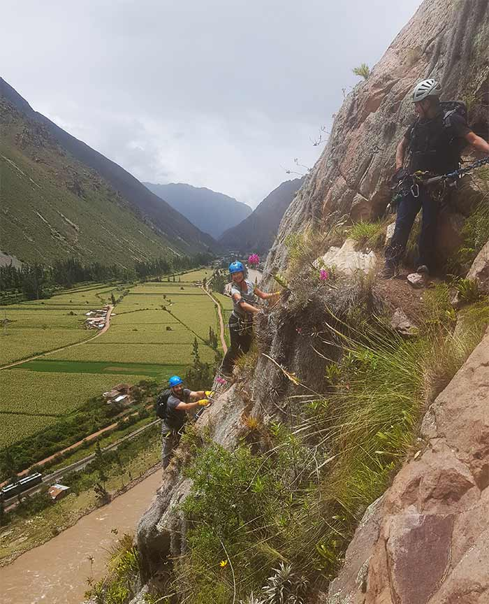 A couple climbing up to the Skylodge Sacred Valley